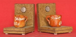 ORENDAIN OLLITAS Bookends, 4 inches in height.  Silver 10 Centavos coin in upright.