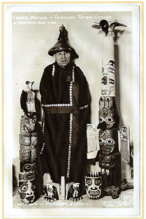 Photo of Casper Mather in regalia with some of his carvings.  Note the pair of Eagle bookends at his feet that closely resemble the bookends in this post.