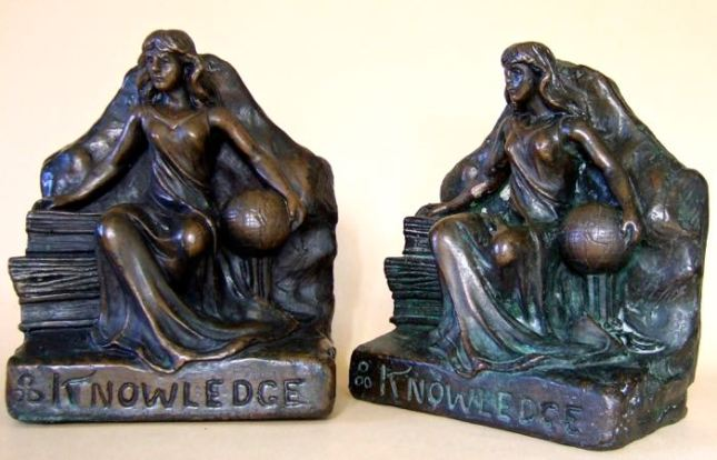 Lady Knowledge:  Electroformed bronze. Height 8.5 inches.  Two impressed marks. One mark of three circles which may be a foundry mark. The other a mark used by Tiffany & Co.