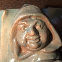 Face of Monk holding spilled chalice