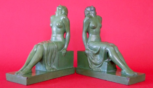Sitting Ladies: Grey metal, Height 7 inches, Inscription: Janle and Made in France. circa 1925.  Janle is suspected to be a pseudonym for Max Le Verrier.