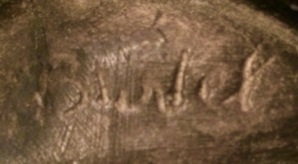 Illegible signature of Artist or foundry on dozing monk bookend.