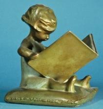 "Child Reading. 6.5"". Gray metal. Frankart, Inc. Circa 1923. DaCosta Collection"