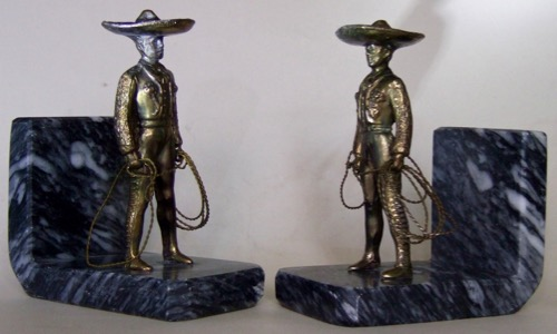 """Charro Bookends: Gray metal and """"mexican marble or onyx"""". Height 6.25 inches. Inscription: ArtemetalicA S.A. Hecho en Mexico."""