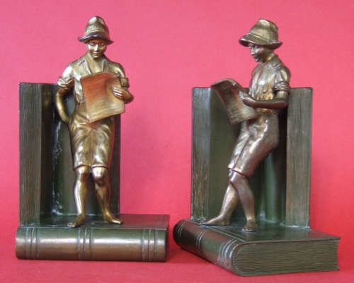 Young Man Reading:  Bronze on gray metal.   Height 8 inches.  Weight 8 pounds per pair.  Shopmark  J.B. 2869. Early twentieth century.