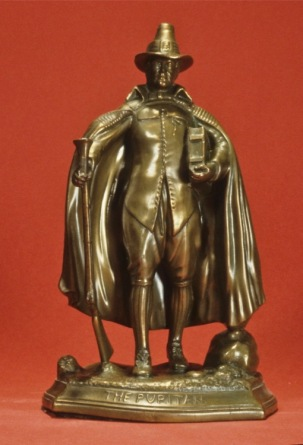 The Puritan. Gray Metal, Height 9.5 inches, circa 1924. Jennings Brothers, JB Shopmark.